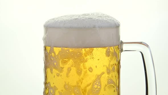 Pouring Lager Beer in A Glass Mug
