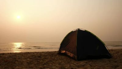 Camping on the beach at the sunrise