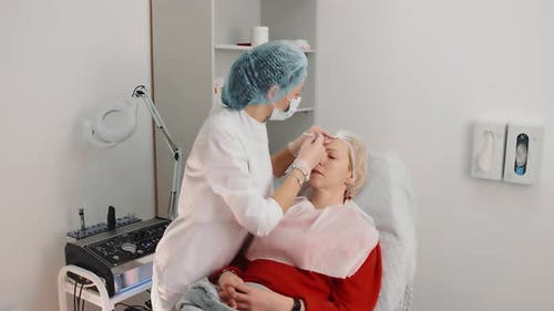 Mesotherapy of a Woman's Face in a Beauty Salon