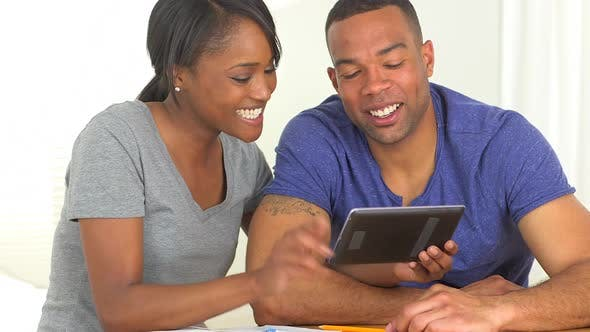 Thumbnail for African couple buying online on tablet