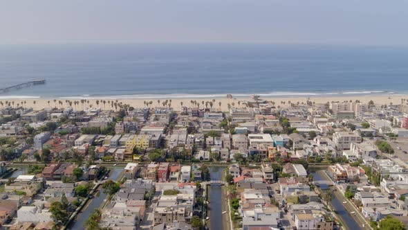 Aerial of residential blocks and calm sea in city