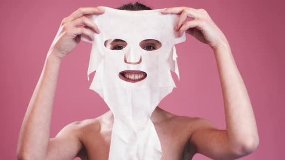 Thumbnail for Smiling Girl Holding Facial Mask
