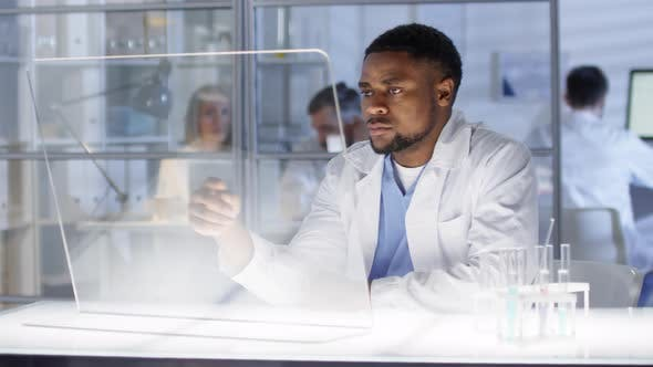 Thumbnail for Black Research Scientist Reading Information on AR Screen