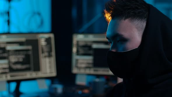 Thumbnail for Asian Hacker in Dark Room with Computers at Night 50