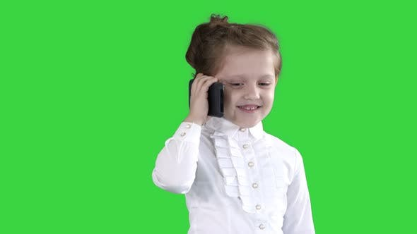 Thumbnail for Beautiful Little Girl, Talking on the Phone on a Green Screen, Chroma Key