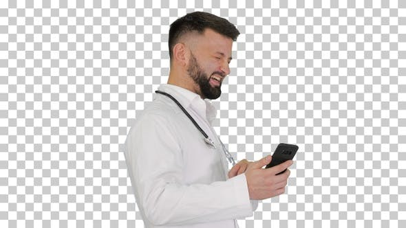 Arab doctor walking using smartphone and laughing, Alpha Channel