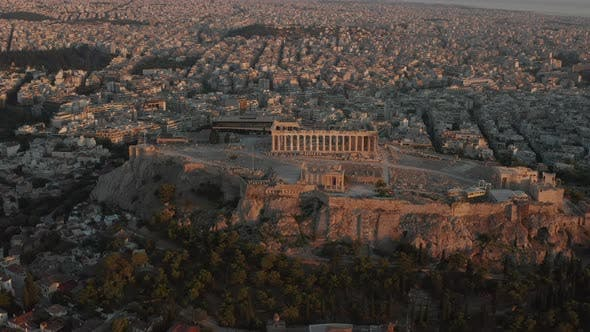 Thumbnail for Aerial Perspective Circling Acropolis of Athens in Golden Hour Sunset Light