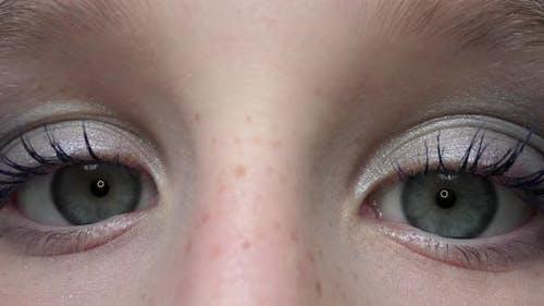 Young Girl Staring at Camera