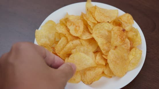 Thumbnail for Potato chip on white plate