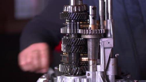 Auto Repair Shop Prepares Transmission Gears For Installation