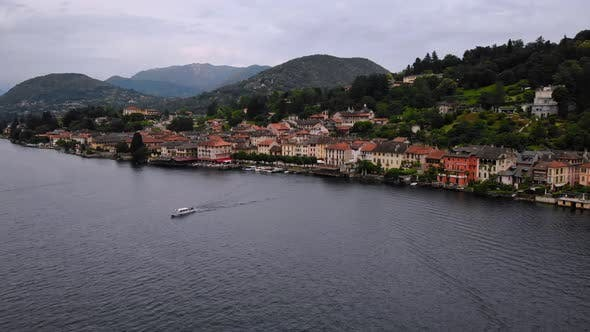 Thumbnail for Drone Fly Above Lake in Italy Cityscape