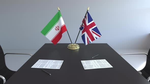 Flags of Iran and United Kingdom on the Table