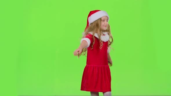 Thumbnail for Child Girl Is Spinning in Her New Year's Costume. Green Screen