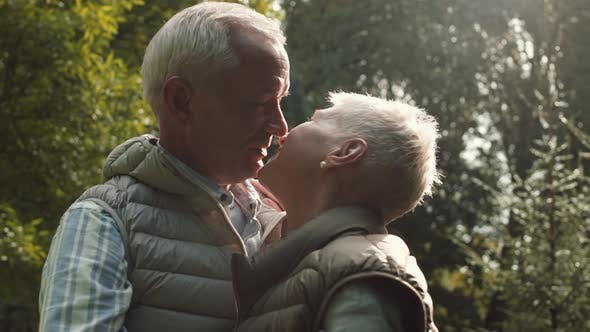 Thumbnail for Older Couple Kissing and Dancing