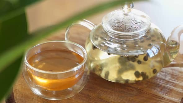 Green Tea Is Brewed in a Glass Teapot.