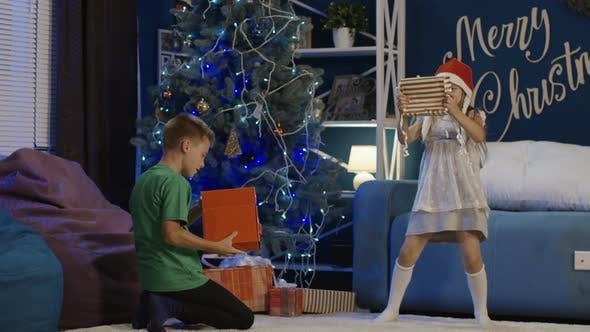 Cover Image for Kids Running and Opening Christmas Presents