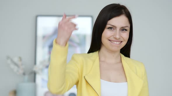 Thumbnail for Inviting Gesture by Young Woman