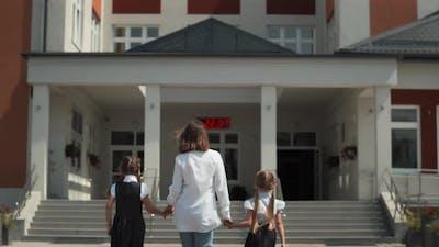 Mother Walking Kids To School
