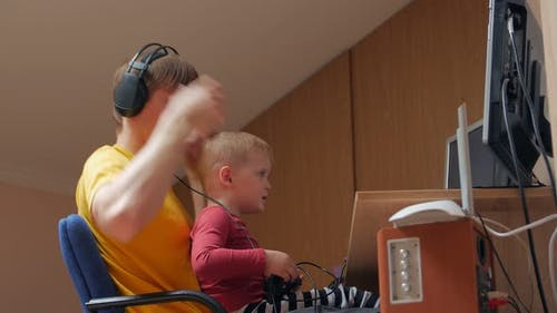 Father And Son Playing With Joysticks