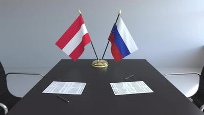 Flags of Austria and Russia and Papers on the Table