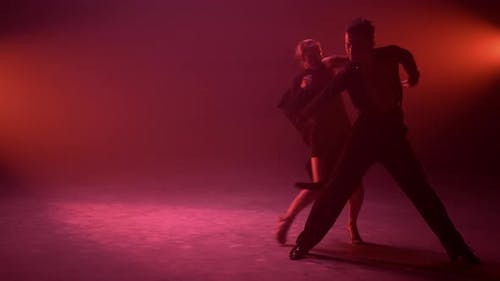 Passionate Couple Bending During Dance Indoors