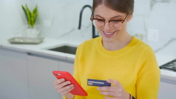 Thumbnail for Beautiful woman online banking using smartphone shopping online with credit card at home lifestyle