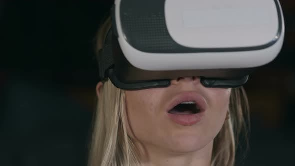 Thumbnail for Young Woman with VR Glasses Watching Movie