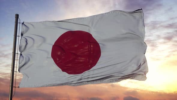 Flag of Japan Waving in the Wind Against Deep Beautiful Sky at Sunset