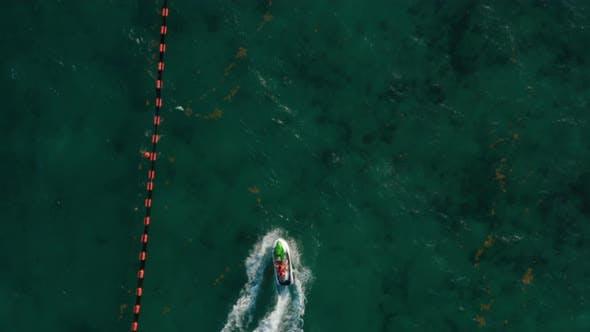 Jetskiing Along the Buoy Line