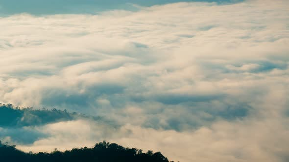 Thumbnail for Clouds Moving Above Mountain