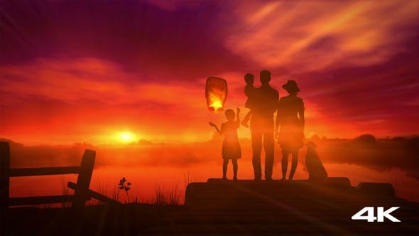 The Family Launches A Chinese Lantern At Sunset 4K
