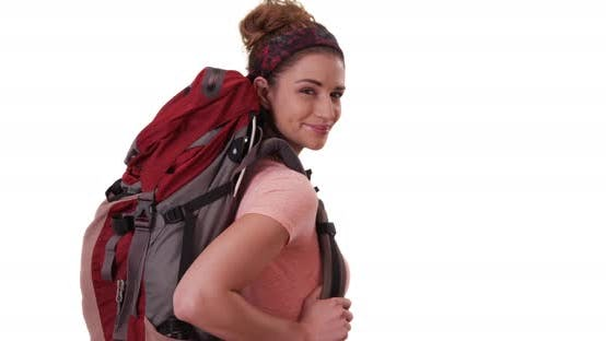 Thumbnail for Portrait of smiling white woman wearing backpack posing on white background