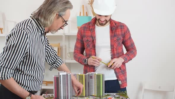Foreman Takes Lessons By Professional Experienced Architect.