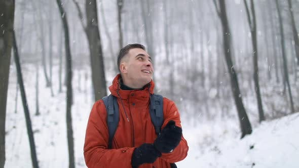 Thumbnail for Man Walking in Forest During Snowfall