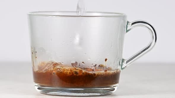 Thumbnail for Pouring hot water in glass cup with coffee
