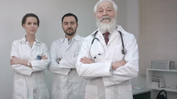 Thumbnail for Three Confident Clinicians in White Coats Looking at Camera