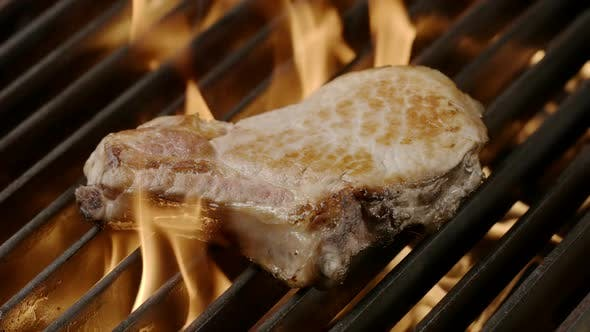 Thumbnail for Pork steak is grilled in a flame