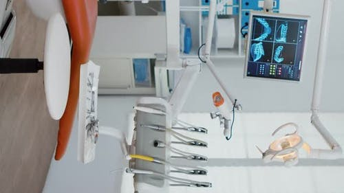 Vertical Video Interior of Modern Equipment Oral Office with Teeth x Ray on Monitors