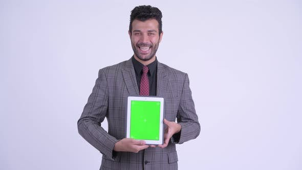 Thumbnail for Happy Bearded Persian Businessman Showing Digital Tablet