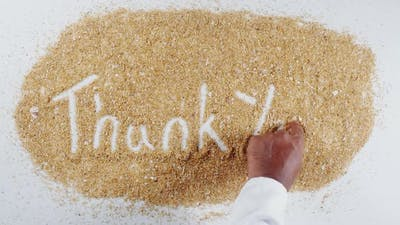 Hand Writing On Beach Sand Thank You
