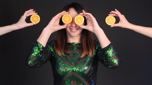 Thumbnail for Happy Woman in Bright Dress Posing with Oranges