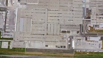 Aerial view of industrial area. Aerial view of warehouse with trucks, industrial background