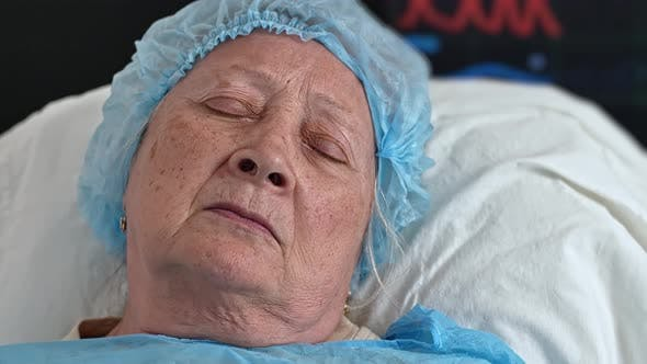 Face of Old Woman Sleeping in Hospital Bed in Hospital