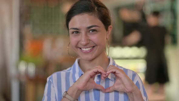 Young Indian Woman Showing Heart Sign with Hand