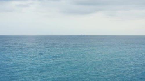 Tugboat tows ship in ocean