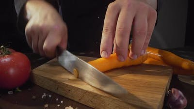 Zooming Shot of Chopping Raw Carrot on the Wooden Board, Cutting Vegetables, Slicing of the Food