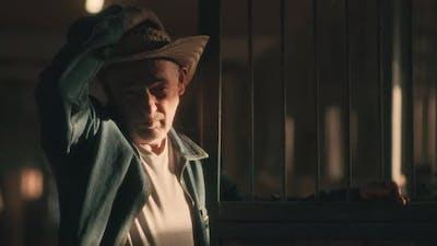 Senior Farmer Putting on Hat