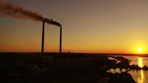 Thumbnail for Harmful emissions from factory at sunset