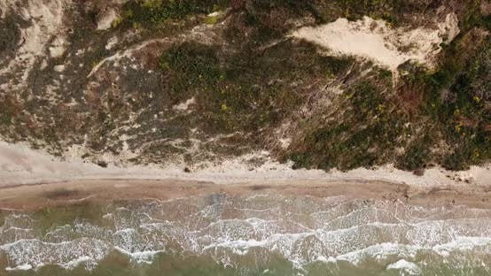 Top Down View of Waves Breaking in the Sand, Flying Over Tropical Sandy Beach and Waves