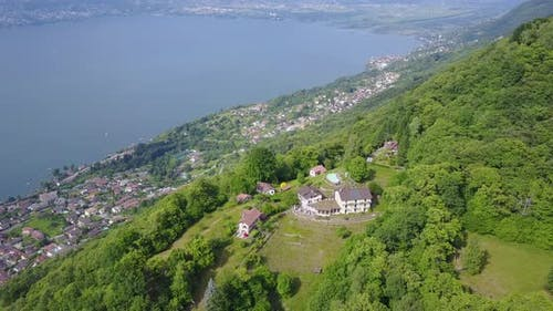 Aerial drone view of the green hills above Lake Maggiore, Switzerland.